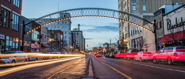 Downtown Flint dusk light streaks Doug Pike Hurley 1412x605 banner