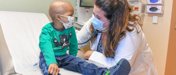 Schnepp with patient at Hurley Medical Center 1412x605