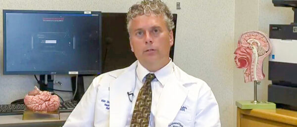 """Dr. Kirk Stucky talks about concussions during a """"medical minute"""" on a local TV news program (2015 file photo)"""